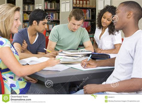 College Students Studying Together In A Library Stock